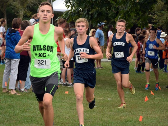 From left, Wilson Memorial's Vincent Leo leads Robert E. Lee's Oliver Wilson-Cook and Jacob Warner, and Fort Defiance's Fisher Wheeler in the early stages of the varsity boys race at the Augusta County Cross Country Invitational at Wilson Workforce and Rehabilitation Center in Fishersville, Va., on Saturday, Sept. 17, 2016.