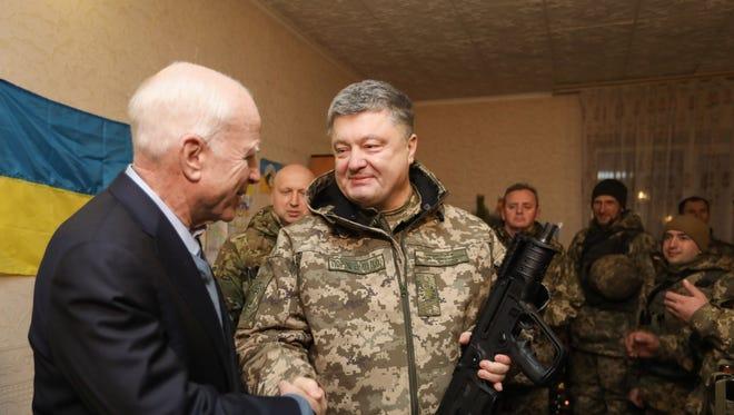 Sen. John McCain, R-Ariz., is shown in a photo  released by the Ukrainian presidential press service meeting with Ukrainian President Petro Poroshenko in the Donetsk region on Dec. 31, 2016.
