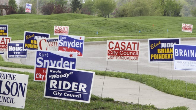 Hamilton County Commissioners are seeking to ban signs in the right of way along roads. The signs pictured were legally placed at a election precinct.