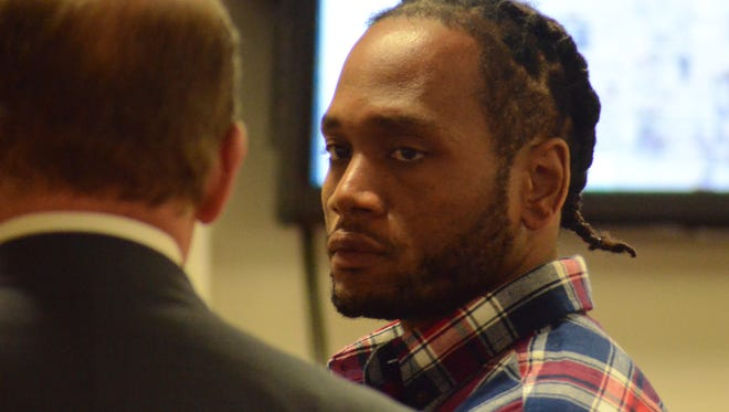 Jeffrey Wimberly confers with his attorney, Ronald Pichlik, during a trial break Wednesday.