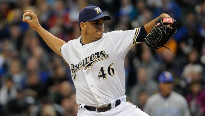 In this 2013 file photo, pitcher Hiram Burgos makes his major league debut against the Chicago Cubs at Miller Park.