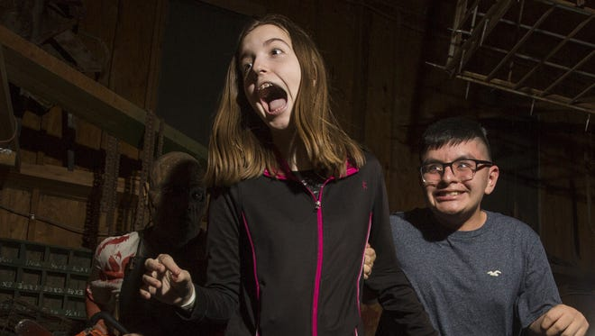 Visitors brave the frights at the Fear Farm Haunted House on Fri. Oct. 6th, 2017 in Phoenix, Ariz.