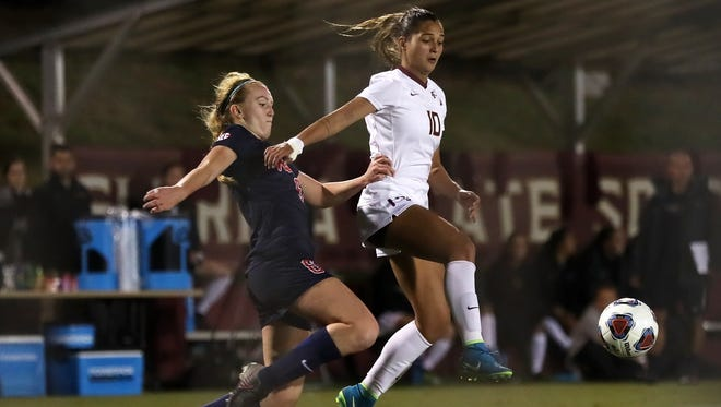 FSU's Deyna Castellanos breaks past Ole Miss' Grace Johnson to score her second goal of the first half during their NCAA tournament game at the Seminole Soccer Complex on Friday night.