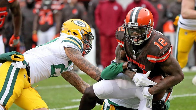 Cleveland receiver Josh Gordon is tackled by Green Bay cornerback Damarious Randall (23). Gordon isn't new to the Browns, although he's missed two complete seasons and parts of two others because of suspensions, including all but the final five games last year. Randall is one of several players new to Cleveland after arriving in an offseason trade.