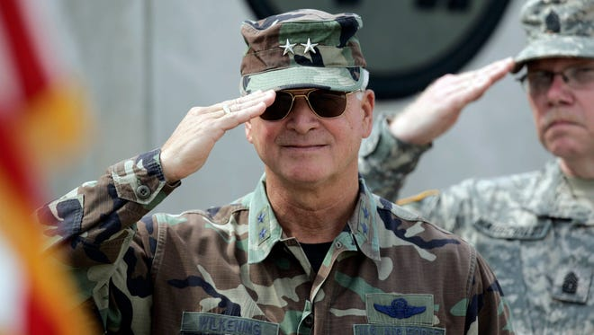 Maj. Gen. Al Wilkening, then the commander-in-chief of the Wisconsin National Guard, salutes the colors during a 2006 ceremony at the Joint Forces Maneuver Center at Camp Atterbury, Ind.