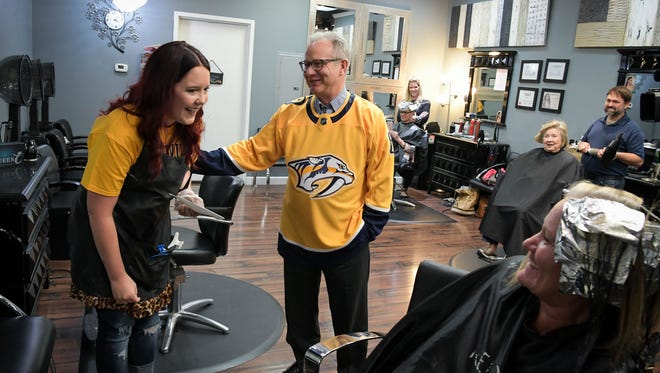 Nashville Mayor David Briley delivered a check to Madison hair stylist Briley Meeks on Friday to cover the shipping costs of a catfish that Meeks sent to the NHL office's this week to protest a call against the Nashville Predators.