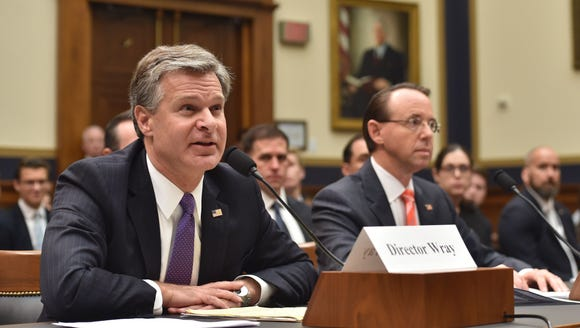 FBI Director Christopher Wray, left, and Deputy Attorney