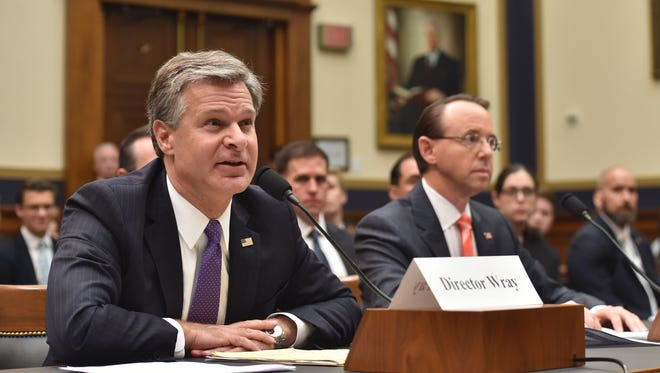 """FBI Director Christopher Wray, left, and Deputy Attorney General Rod Rosenstein testify before a congressional House Judiciary Committee hearing on """"Oversight of FBI and DOJ Actions Surrounding the 2016 Election."""""""