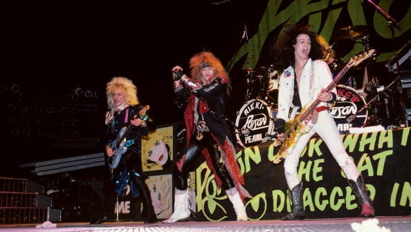 Poison performs at Madison Square Garden in 1987. Bassist Bobby Dall, (right) calls Palm Bay his childhood home.