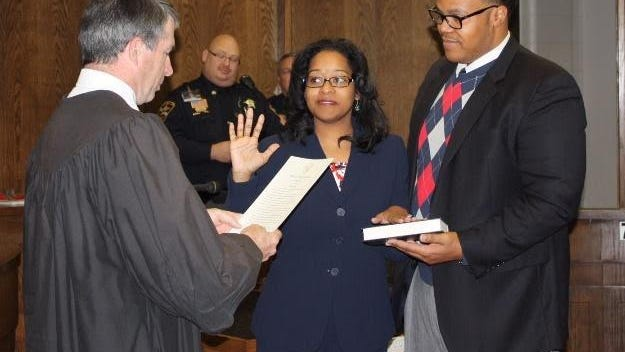 Six and a half years ago Judge Jeannette Reeves (center) was sworn in as a district court judge. Now she assumes the role of chief district court judge.