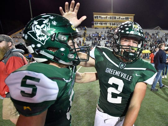 Greeneville's Cade Ballard (2) and Garrin Shuffler (5) celebrate the team's 54-13 loss in the Class 4A state championship game at Tucker Stadium in Cookeville, Tenn., Friday, Dec. 1, 2017.