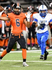 Northville quarterback Christian Williams (6) throws