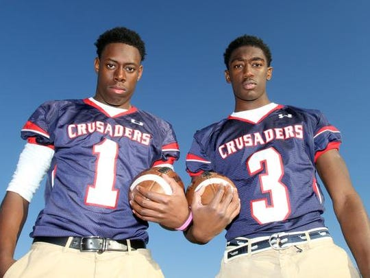 From left, Stepinac football players Gavin Heslop (1) and Demarcus Miller (3) are photographed at the school in White Plains  Nov. 19, 2014. Stepinac will play rival Iona Prep this Saturday in the CHSFL championship game.