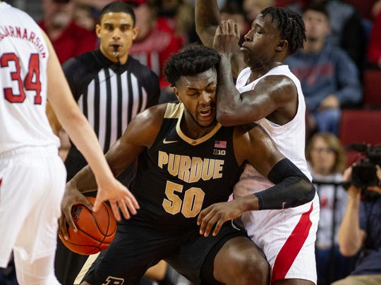 Purdue forward Trevion Williams (50) drives the basket against Nebraska forward Kevin Cross during the first half of an NCAA college basketball game in Lincoln, Neb., Sunday, Dec. 15, 2019. (AP Photo/John Peterson)