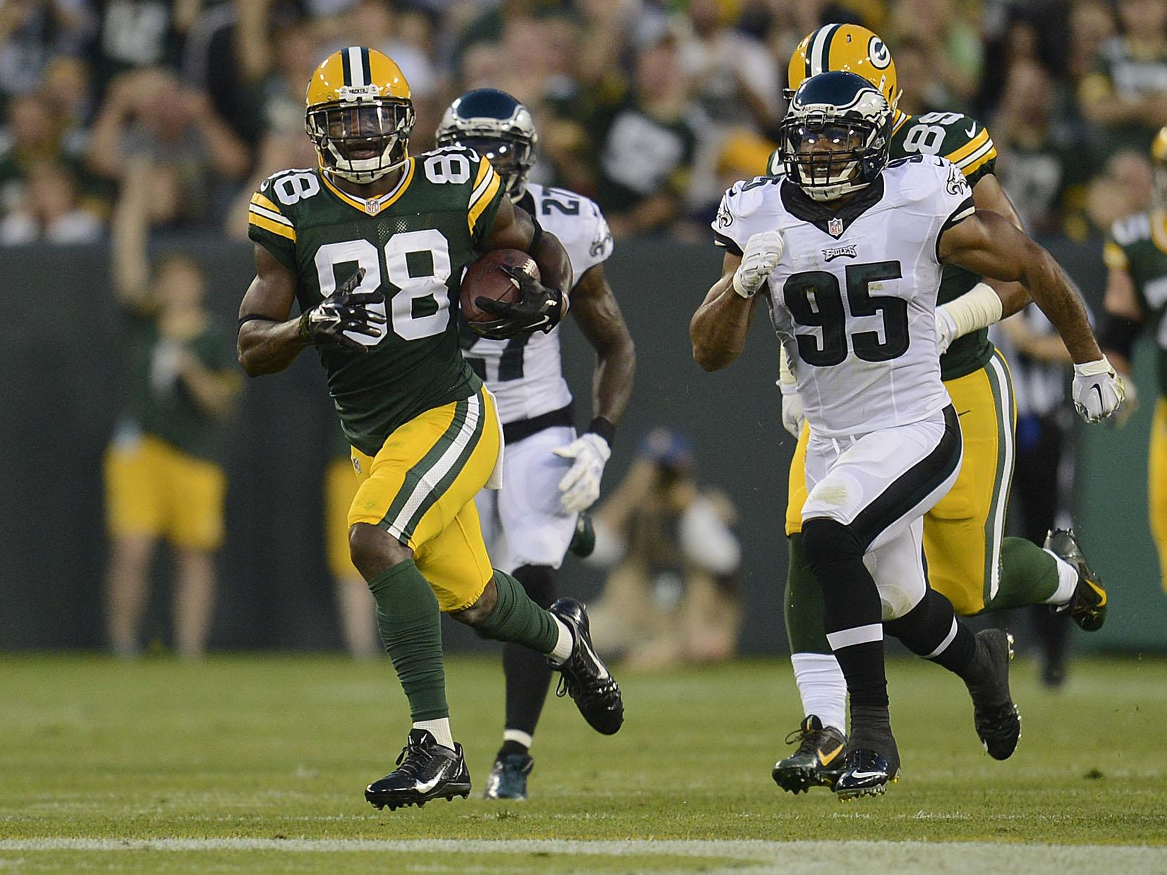 Green Bay Packers receiver Ty Montgomery (88) runs with the ball after making a catch against the Philadelphia Eagles during their preseason game at Lambeau Field.