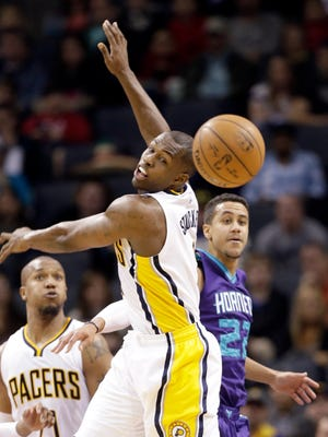 Indiana Pacers' Rodney Stuckey, front, tries to stop a pass from Charlotte Hornets' Brian Roberts, back, during the first half of an NBA basketball game in Charlotte, N.C., Saturday, Jan. 17, 2015. (AP Photo/Chuck Burton)