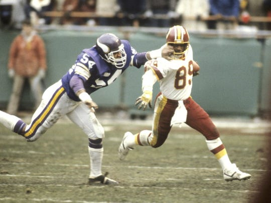 Minnesota Vikings Fred McNeill (54) in action vs Washington Alvin Garrett (89). Washington, DC 1/15/1983