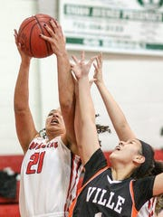 Bound Brook's Janee'a Summers (21) outleaps Somerville's