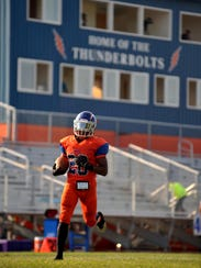 Millville's Clayton Scott (28) warms up before the