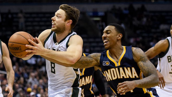 Nov 3, 2016; Milwaukee, WI, USA;  Milwaukee Bucks guard Matthew Dellavedova (8) drives for the basket against Indiana Pacers guard Jeff Teague (44) in the fourth quarter at BMO Harris Bradley Center.