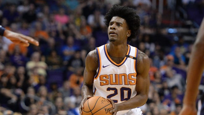 Oct 25, 2017; Phoenix, AZ, USA; Phoenix Suns forward Josh Jackson (20) shoots the ball against the Utah Jazz in the first half at Talking Stick Resort Arena. Mandatory Credit: Jennifer Stewart-USA TODAY Sports