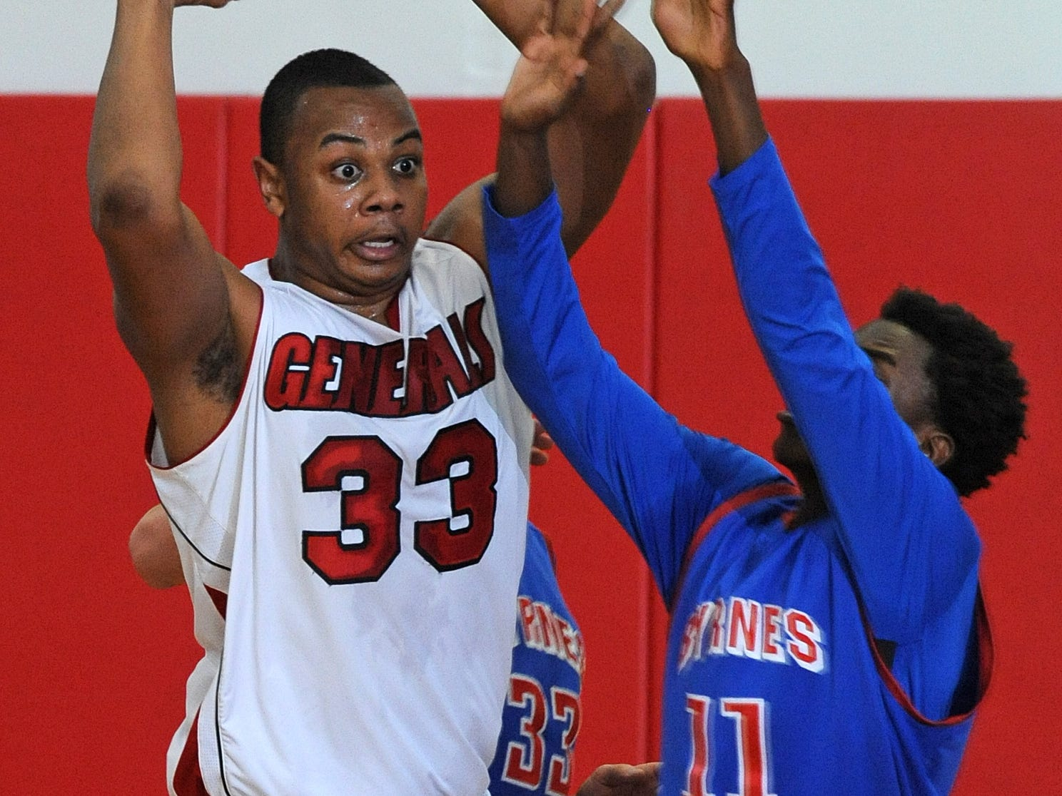 Wade Hampton's Jalen Williams (33), shown in this Jan. 24 game against Byrnes, pulled down nine rebounds in Saturday's North Carolina-South Carolina all-star game.