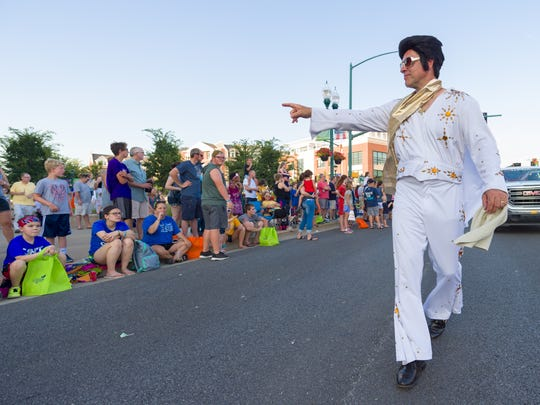 An Elvis impersonator perform's during the 2018 Spark!Fishers festival.