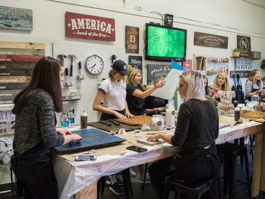 Participants enjoy a fun-filled evening of wood crafting,