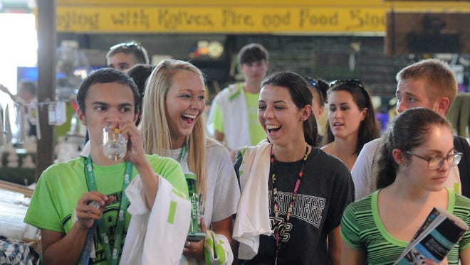 From left, York College freshmen Joshua Motta, Samantha Wells, Cassidy Jagiela and Leanne Royal walk through Central Market on Aug. 29 as part of the College Town Takeover event.