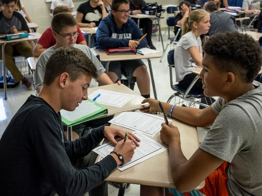 Eighth-grade students Evan Woodard, 13, and D'Marco Singleton, 13, work on an assignment together in a social studies class Tuesday, September 13, 2016 at Marysville Middle School. Marysville Public Schools have received the most Schools of Choice applications of any district in St. Clair County and brought in 114 students this academic year.