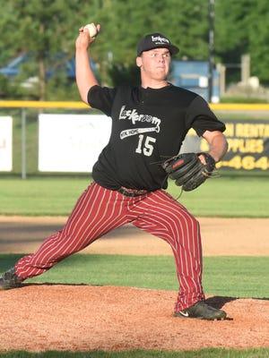 Lockeroom's Hunter Wojcik delivers a pitch Saturday night during the alumni exhibition game.