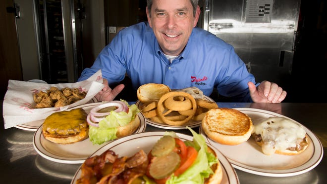 New Frisch's CEO Jason Vaughn poses in the kitchen at the Frisch's Big Boy in Covington.