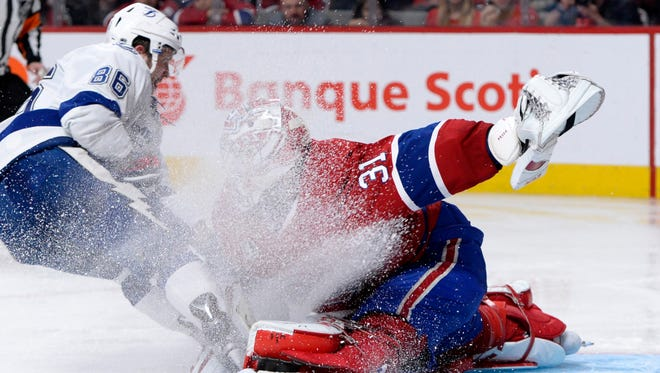 Montreal Canadiens goalie Carey Price (31) makes a save against Tampa Bay Lightning forward Nikita Kucherov (86) during the overtime period in game two of the second round of the 2015 Stanley Cup Playoffs at the Bell Centre.