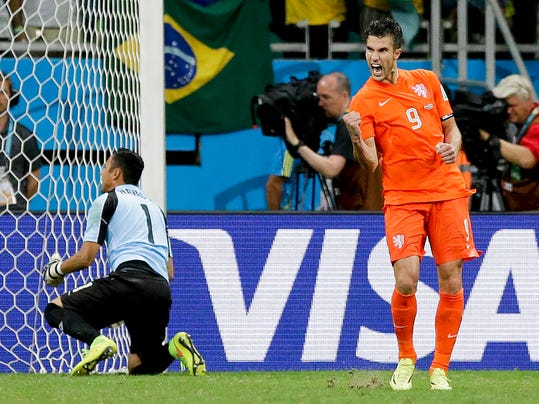 Netherlands' Robin van Persie celebrates after scoring in a penalty shoot out during the World Cup quarterfinal soccer match between the Netherlands and Costa Rica at the Arena Fonte Nova in Salvador, Brazil, Saturday, July 5, 2014. (AP Photo/Matt Dunham)