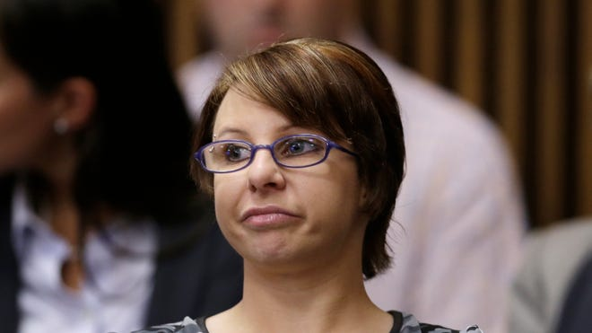 Michelle Knight in a Cleveland courtroom Aug. 1, 2013, during the sentencing phase for Ariel Castro, who pleaded guilty to abducting and abusing her and two other women for a decade. Castro committed suicide in jail in September.