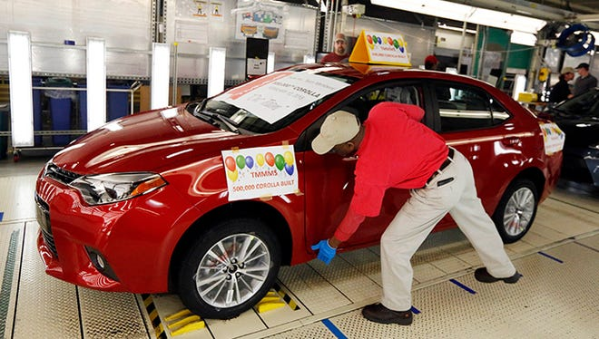 A quality inspector checks the finish of the 500,000th Toyota Corolla to be assembled at the Toyota Motor Manufacturing plant in Blue Springs, Miss., Thursday, Feb. 12, 2015. The plant is the only one in the United States that builds the entire Corolla line.