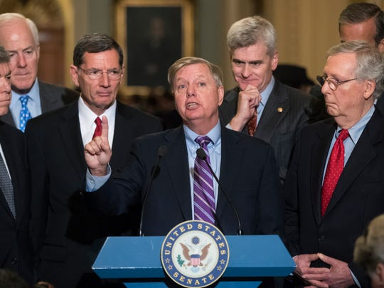 Sen. Lindsey Graham speaks to reporters as he pushes