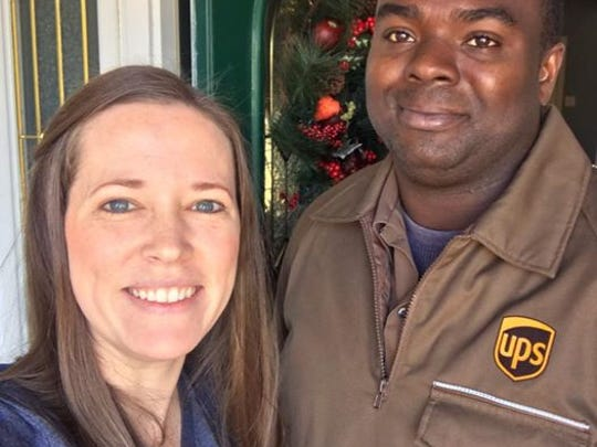 "Lisa and Antonio, the UPS courier who Lisa says has gone ""above and beyond"" to get her holiday gifts delivered."