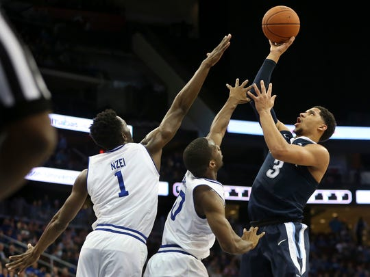 Villanova's Josh Hart (3) takes a shot past Seton Hall defenders Michael Nzei, (1) of Nigeria, and Khadeen Carrington (0) during the second half of Saturday's game.