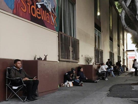 On Thursday, Ivan Vizueta waits in line at the Coalition