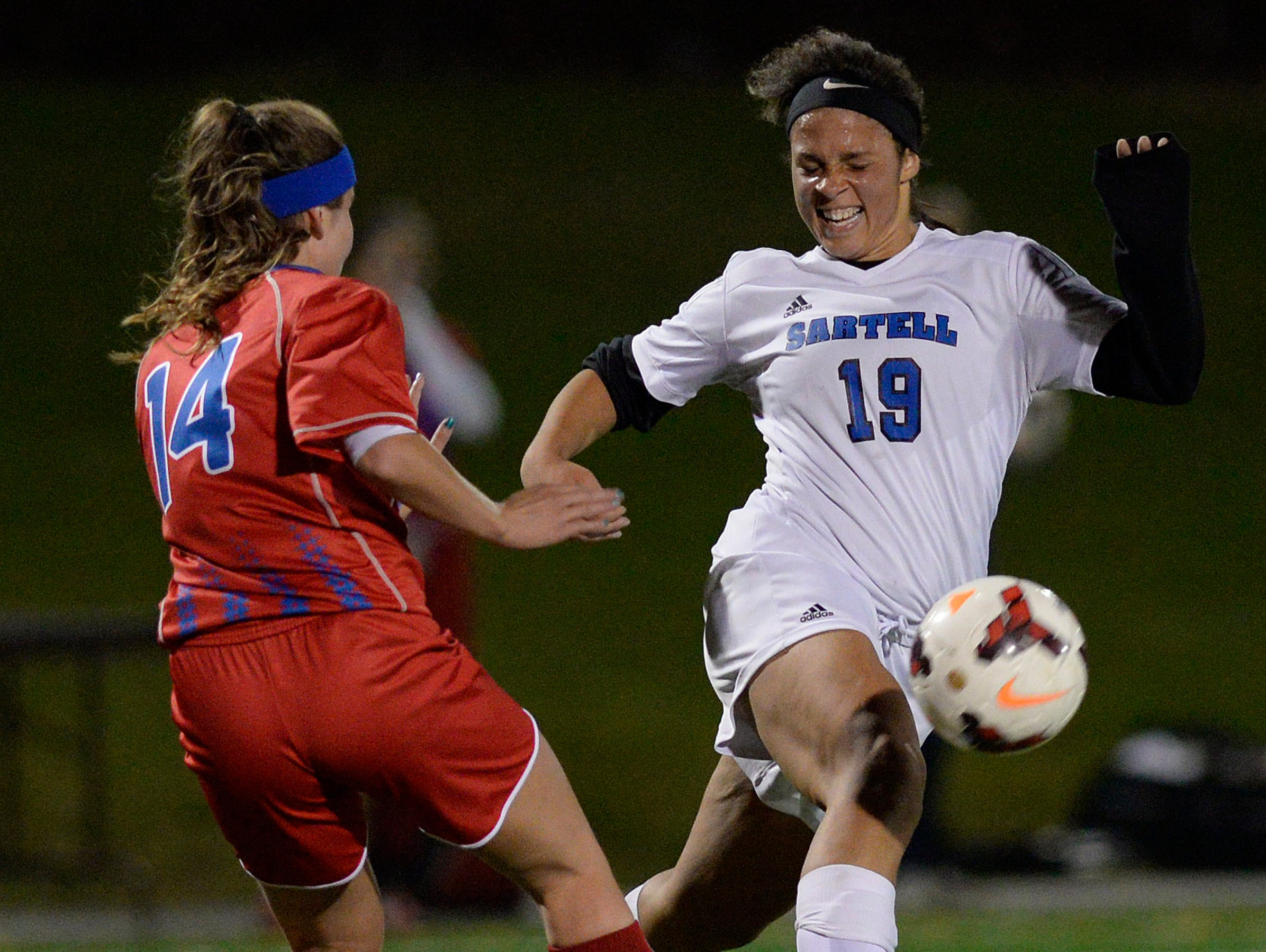 Sartell's Jaylia Ellis (19) gets control of the ball from St. Cloud Apollo's Mikaela Soltis (14) in the first half of their Sect. 8A championship game Thursday, Oct. 22 at Husky Stadium.