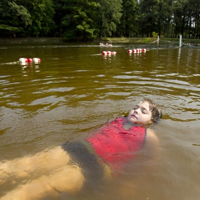 Bella Williams, 6, floats on her back in the swimming