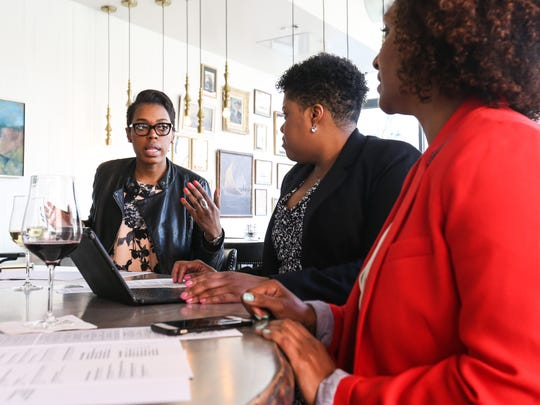 Johniece Ray (left) Latisha Bracy and Kia Ervin meet at Merchant Bar in Wilmington Tuesday. They are part of an effort to attract and empower young professionals in the city.
