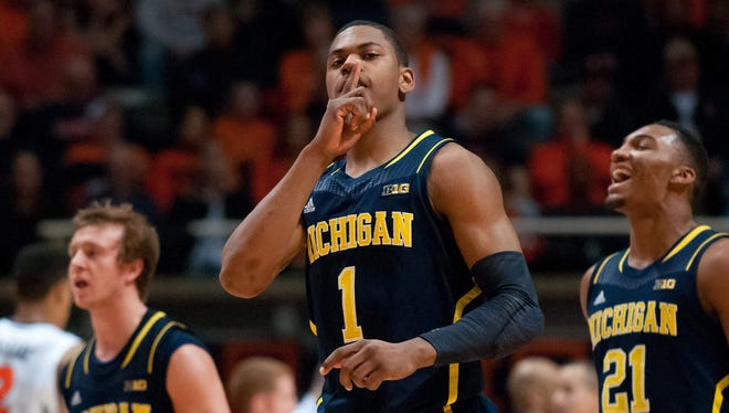 Michigan Wolverines forward Glenn Robinson III gestures after dunking the ball during the first half against the Illinois Fighting Illini at State Farm Center.