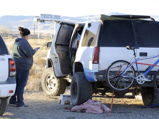 Human Services Case Manager Mikelynn McKinney talks to a man living in vehicle with his dog.