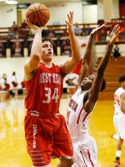George Karlaftis of West Lafayette with a shot over James Burns of Lafayette Jeff Tuesday, February 7, 2017, in Lafayette. Jeff coasted past West Lafayette 74-51.