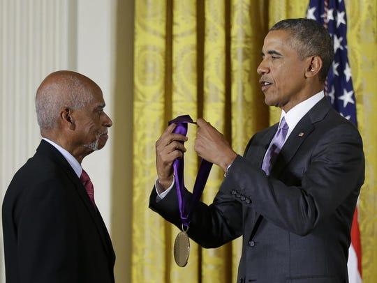 President Barack Obama awards the 2014 National Medal