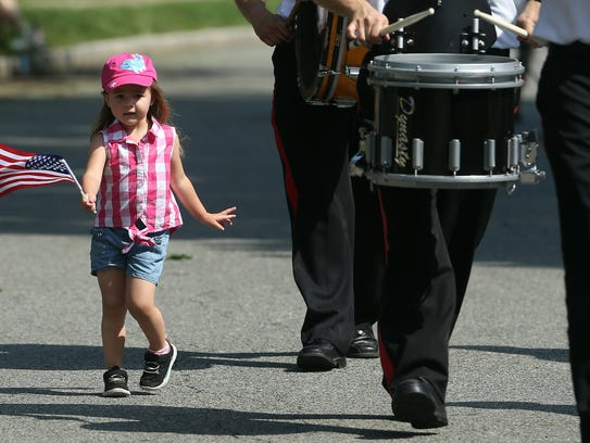 3-year-old Emma Johnson of Woodbridge dances along