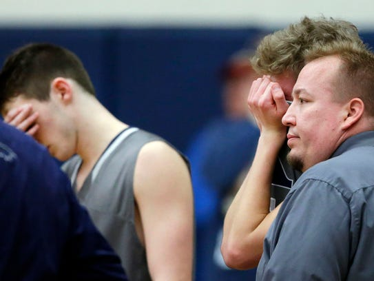 Xavier coach Matt Klarner talks with Sam Ferris following