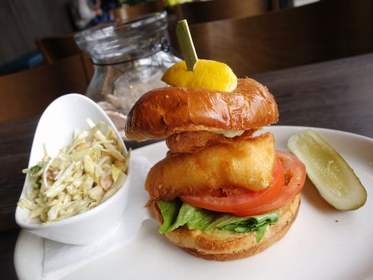 Beer battered halibut sandwich with peach cashew slaw